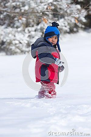 Child walking on snow