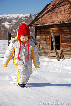 Child walking in snow