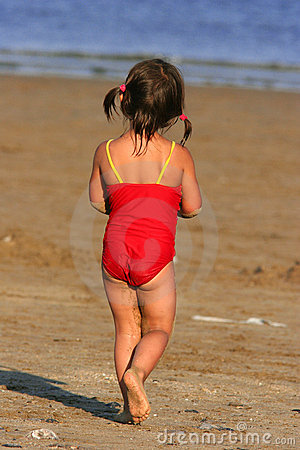 Child Wandering Towards The Sea