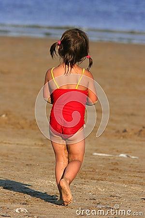 Free Child Wandering Towards The Sea Stock Photography - 182642