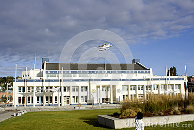 Child watching plane flying over museum Editorial Photo