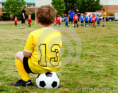 Child watching soccer game