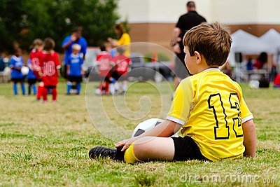 Child watching youth soccer game