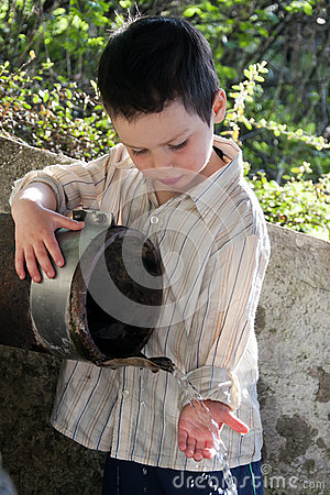Child  in water fountain