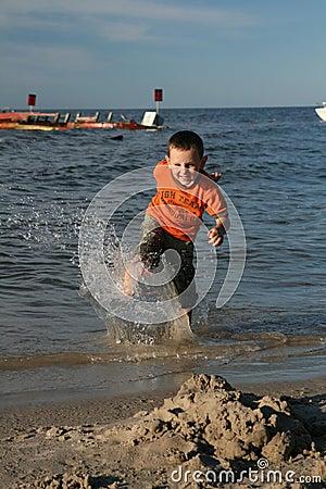 Child, water and fun. Beach fun.