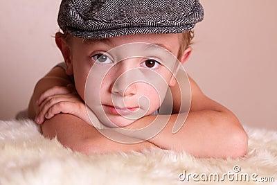 Child wearing Flat Cap