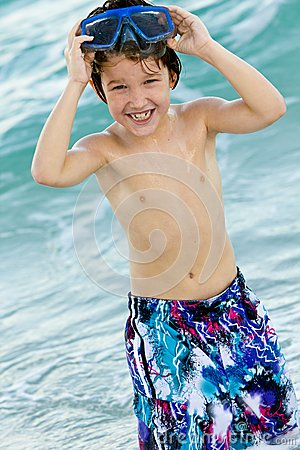 Child wearing goggle and swimming trunks
