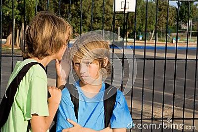 Child whispering at school