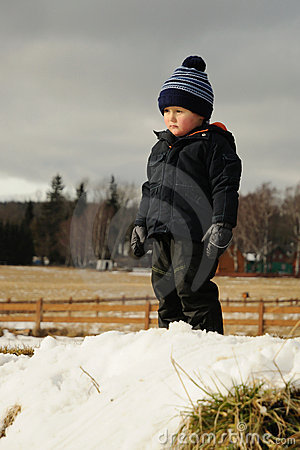 Child in winter countryside