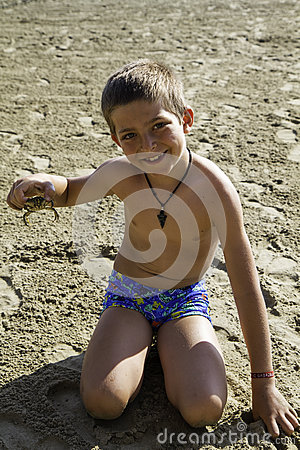 Free Child With Crab Stock Photo - 75016800