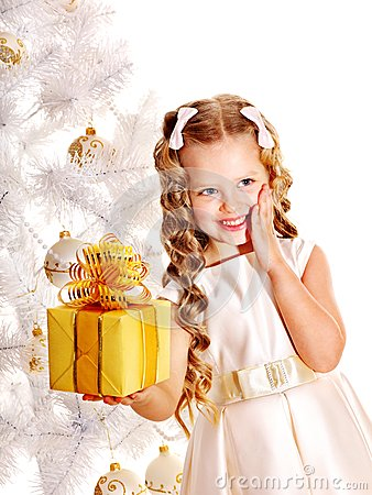 Free Child With Gift Box Near White Christmas Tree. Royalty Free Stock Images - 27569169