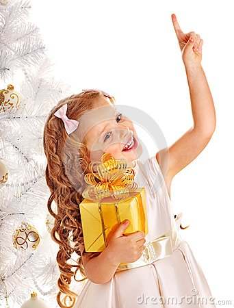 Free Child With Gift Box Near White Christmas Tree. Stock Images - 27677604