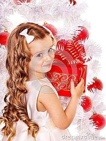 Free Child With Gift Box Near White Christmas Tree. Stock Photos - 27849933