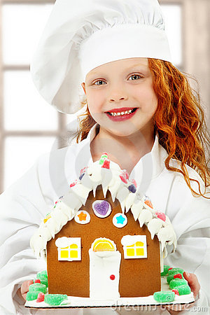 Free Child With Gingerbread House At Christmas As Chef Royalty Free Stock Photography - 22176297