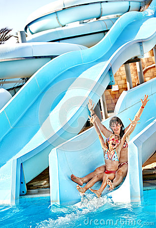 Free Child With Mother On Water Slide At Aquapark. Stock Photography - 28696212