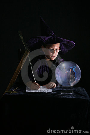 Child wizard writing a spell