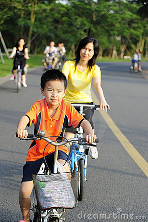 A child and  a women cycling