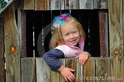 Child in wooden house