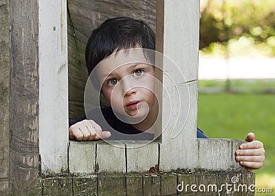 Child in wooden window