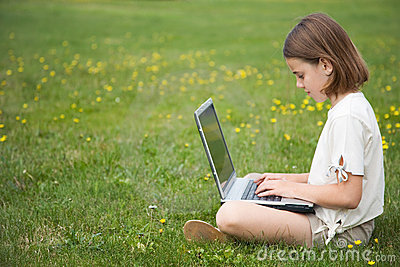 Child working laptop outside