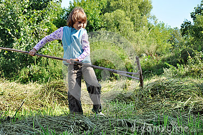 Child working with a rake