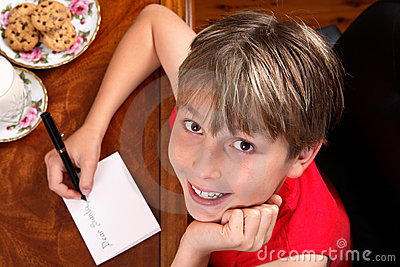 Child writes a letter or card
