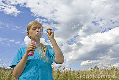 Childrem blowing bubbles