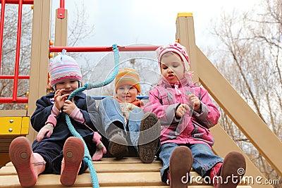 Children on artificial hill on playground