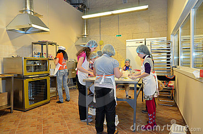 Children bake bread in the bakery Editorial Photography