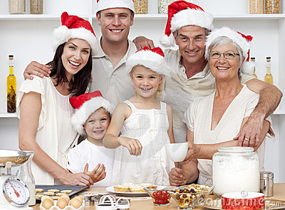 Children baking Christmas cakes with their family