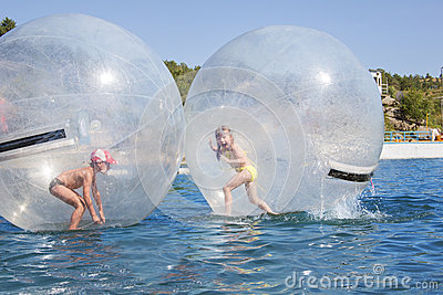 Children in a balloon floating on water.