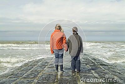 Children on the beach, overlooking the sea
