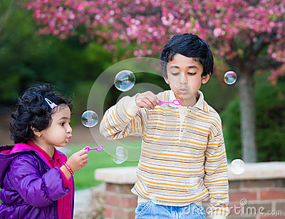 Children Blowing Bubbles in Their Yard