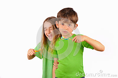 Children, boy and girl brush their teeth and laugh