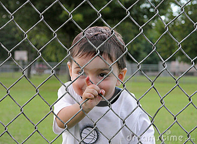 Children:  Boy Peering Through Fence