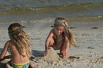 Children building sandcastle