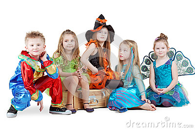 Children in carnival costumes sit on chest