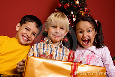 Children carrying christmas gift