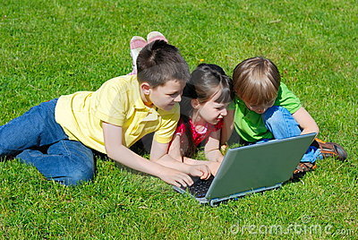 Children with computer outdoor