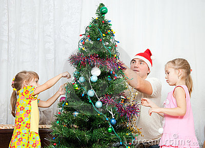 Children decorate the Christmas tree