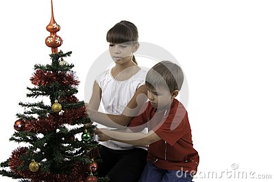 Children decorate a New Year tree
