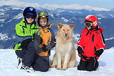 Children with dog in Alps