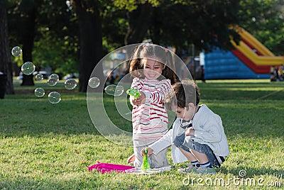 Children doing soap bubbles