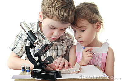 Children draw diagram near microscope