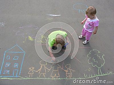 Children drawing on asphalt