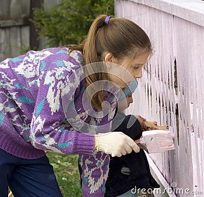 Children dye the porch of rural house