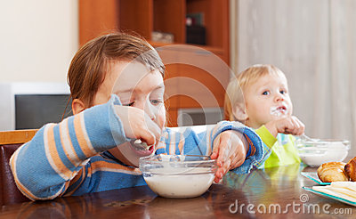 Children eating dairy breakfast
