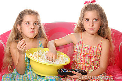 Children eating popcorn watchi