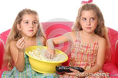 Children eating popcorn watchi