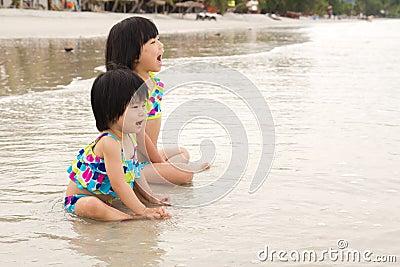 Children enjoy waves on beach